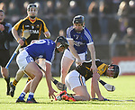 James Murphy of Ballyea in action against Liam Markham and Martin Oige Murphy of  Cratloe during the county senior hurling final at Cusack Park. Photograph by John Kelly.