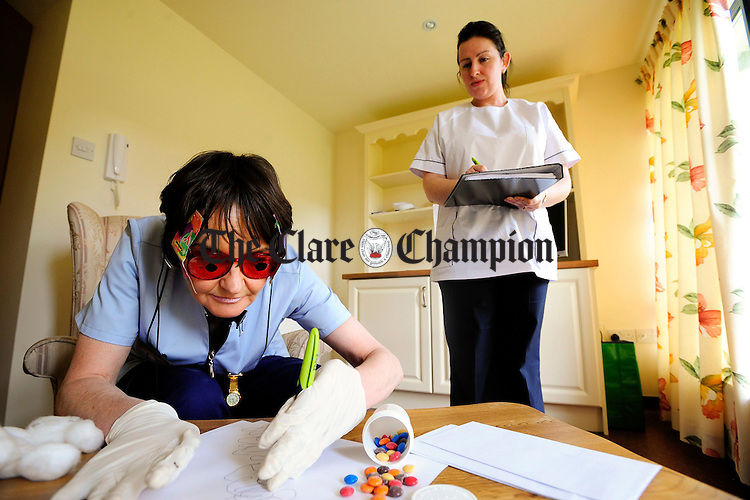 Marie O'Malley (l), going through a dementia simulation, as Valerie Vaughan audits.Pic Arthur Ellis.