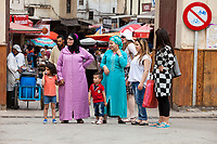 Fes, Morocco.  Moroccan Women in Traditional and Modern Dress Styles.