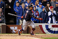 Cleveland Indians Francisco Lindor (12) hits an RBI single in the sixth inning during Game 5 of the Major League Baseball World Series against the Chicago Cubs on October 30, 2016 at Wrigley Field in Chicago, Illinois.  (Mike Janes/Four Seam Images)