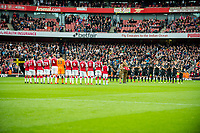 Players observe a moments silence during the Premier League match between Arsenal and Swansea City at Emirates stadium, London, England, UK. Saturday 28 October 2017