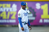 Burlington Royals pitching coach Carlos Martinez (40) watches his starting pitcher warmup in the bullpen prior to the game against the Pulaski Yankees at Burlington Athletic Stadium on August 25, 2019 in Burlington, North Carolina. The Yankees defeated the Royals 3-0. (Brian Westerholt/Four Seam Images)
