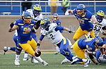 BROOKINGS, SD - MAY 8: Nolan Henderson #2 of the Delaware Fightin Blue Hens scrambles away from Caleb Sanders #99 of the South Dakota State Jackrabbits on May 8, 2021 in Brookings, South Dakota. (Photo by Dave Eggen/Inertia)