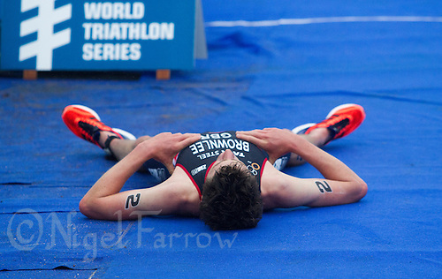 15 SEP 2013 - LONDON, GBR - Jonathan Brownlee (GBR) of Great Britain recovers after losing the elite men's ITU 2013 World Triathlon Series Grand Final and the series to Javier Gomez (ESP) (right) of Spain after a sprint for the line in Hyde Park in London, Great Britain (PHOTO COPYRIGHT © 2013 NIGEL FARROW, ALL RIGHTS RESERVED)