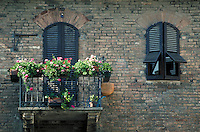 Architectural detail of balcony and flowers. Italy Europe.