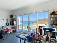 BNPS.co.uk (01202) 558833. <br /> Pic: LillicrapChilcott/BNPS<br /> <br /> A 150-year-old wooden bungalow with stunning sea views and private beach access has gone on the market for £1m.<br /> <br /> The Bungalow was one of the first buildings in the Cornish village of Porthtowan and overlooks the resort's sandy beach which is popular with surfers.<br /> <br /> The two-bedroom house and detached artist's studio are on the market for the first time in 26 years.