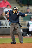 Home plate umpire Matt Benham calls a player out on strikes during a Midwest League game between the Great Lakes Loons and the Dayton Dragons at Fifth Third Field April 21, 2009 in Dayton, Ohio. (Photo by Brian Westerholt / Four Seam Images)