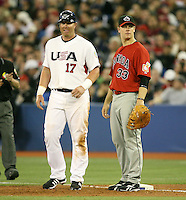 March 7, 2009:  First baseman Justin Morneau (33) of Canada and Adam Dunn (17) of Team USA during the first round of the World Baseball Classic at the Rogers Centre in Toronto, Ontario, Canada.  Team USA defeated Canada 6-5 in both teams opening game of the tournament.  Photo by:  Mike Janes/Four Seam Images