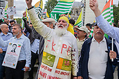 A supporter of the Jammu & Kashmir Peace Foundation (JKPF). Kashmiris protest outside Parliament following India's actions in Indian-controlled Kashmir.  Westminster, London.
