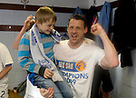 St Johnstone v Morton....02.05.09.Alan Main celebrates in the dressing room with his son Christopher.Picture by Graeme Hart..Copyright Perthshire Picture Agency.Tel: 01738 623350  Mobile: 07990 594431