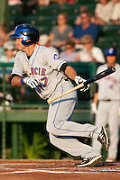 Center Fielder Matt Den Dekker of the St. Lucie Mets lays down a bunt during the game against the Daytona Beach Cubs at Jackie Robinson Ballpark on May 25, 2011 in Daytona Beach, Florida. Photo by Scott Jontes / Four Seam Images