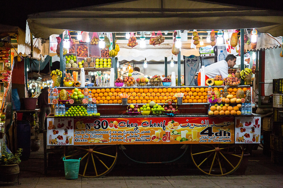 Marrakesh, Morocco.  Vendor of Fruit and Juice Drinks in the Souk, Nighttime.