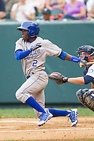 D.J. Burt (2) of the Burlington Royals follows through on his swing against the Pulaski Mariners at Calfee Park on June 20, 2014 in Pulaski, Virginia.  The Mariners defeated the Royals 6-4. (Brian Westerholt/Four Seam Images)