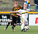 Dumbarton's Scott Agnew holds off Alloa's Ryan McCord.