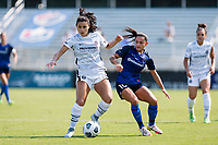 CARY, NC - SEPTEMBER 12: Debinha #10 of the NC Courage defends against Rocky Rodriguez #11 of the Portland Thorns during a game between Portland Thorns FC and North Carolina Courage at Sahlen's Stadium at WakeMed Soccer Park on September 12, 2021 in Cary, North Carolina.