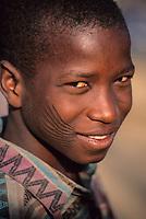 Zinder, Niger.  Young Hausa Man Showing Traditional Tribal Facial Scarification.