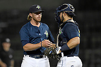Pitcher Cameron Griffin (33) of the Columbia Fireflies shakes hande with catcher Brandon Brosher after the final out of a game against the Charleston RiverDogs on Monday, August 7, 2017, at Spirit Communications Park in Columbia, South Carolina. Columbia won, 6-4. (Tom Priddy/Four Seam Images)
