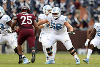 BLACKSBURG, VA - OCTOBER 19: Brian Anderson #68 of the University of North Carolina prepares to block Rayshard Ashby #25 of Virginia Tech during a game between North Carolina and Virginia Tech at Lane Stadium on October 19, 2019 in Blacksburg, Virginia.