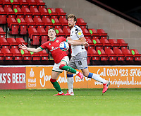 10th October 2020; Bescot Stadium, Walsall, West Midlands, England; English Football League Two, Walsall FC versus Colchester United; Alfie Bates of Walsall is tackled by Tom Eastman of Colchester United