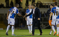 Gareth Ainsworth manager of Wycombe Wanderers shakes hands with former Wycombe player Jermaine Easter of Bristol Rovers during the Johnstone's Paint Trophy match between Bristol Rovers and Wycombe Wanderers at the Memorial Stadium, Bristol, England on 6 October 2015. Photo by Andy Rowland.