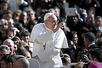 Pope Francis speaks during a private audience to members of the media at the Paul VI hall at the Vatican. on March 16, 2013
