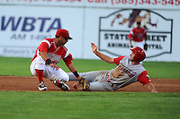 Batavia Muckdogs second baseman Luis Ortiz (26) tags out Andrew Pullin attempting to steal during a game against the Williamsport Crosscutters on August 16, 2013 at Dwyer Stadium in Batavia, New York.  Batavia defeated Williamsport 5-2.  (Mike Janes/Four Seam Images)