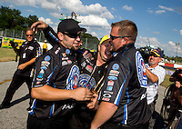 Sept. 2, 2013; Clermont, IN, USA: NHRA funny car driver Robert Hight celebrates with his crew after winning the US Nationals at Lucas Oil Raceway. Mandatory Credit: Mark J. Rebilas-