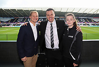 Letou CEO Paul Fox (C) with Sports Wales Charity during the English Premier League soccer match between Swansea City and Manchester United at Liberty Stadium, Swansea, Wales, UK. Saturday 18 August 2017