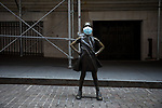 The Fearless Girl statue stands with a face mask during the coronavirus pandemic across from the closed New York Stock Exchange (NYSE) in New York, U.S., on Wednesday, April 1, 2020.  Photograph by Michael Nagle
