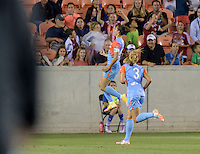 Houston Texas - Carli Lloyd (10) of the Houston Dash celebrates her goal in the second half putting Houston up 2-1 over the Chicago Red Stars on Saturday, April 16, 2016 at BBVA Compass Stadium in Houston Texas.  The Houston Dash defeated the Chicago Red Stars 3-1.