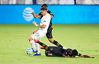CARSON, CA - SEPTEMBER 06: Latif Blessing #7 of LAFC attempts a tackle on Cristian Pavon #10 of the Los Angeles Galaxy his he moves towards the goal during a game between Los Angeles FC and Los Angeles Galaxy at Dignity Health Sports Park on September 06, 2020 in Carson, California.