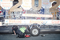 "Police help inflate a tire on the ""Trump Unity Bridge"" before the Straight Pride Parade in Boston, Massachusetts, on Sat., August 31, 2019. The parade was organized in reaction to LGBTQ Pride month activities by an organization called Super Happy Fun America."