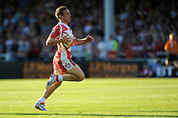 20130801 Copyright onEdition 2013 ©<br /> Free for editorial use image, please credit: onEdition.<br /> <br /> Drew Cheshire of Gloucester Rugby 7s runs in a try during the J.P. Morgan Asset Management Premiership Rugby 7s Series.<br /> <br /> The J.P. Morgan Asset Management Premiership Rugby 7s Series kicks off for the fourth season on Thursday 1st August with Pool A at Kingsholm, Gloucester with Pool B being played at Franklin's Gardens, Northampton on Friday 2nd August, Pool C at Allianz Park, Saracens home ground, on Saturday 3rd August and the Final being played at The Recreation Ground, Bath on Friday 9th August. The innovative tournament, which involves all 12 Premiership Rugby clubs, offers a fantastic platform for some of the country's finest young athletes to be exposed to the excitement, pressures and skills required to compete at an elite level.<br /> <br /> The 12 Premiership Rugby clubs are divided into three groups for the tournament, with the winner and runner up of each regional event going through to the Final. There are six games each evening, with each match consisting of two 7 minute halves with a 2 minute break at half time.<br /> <br /> For additional images please go to: http://www.w-w-i.com/jp_morgan_premiership_sevens/<br /> <br /> For press contacts contact: Beth Begg at brandRapport on D: +44 (0)20 7932 5813 M: +44 (0)7900 88231 E: BBegg@brand-rapport.com<br /> <br /> If you require a higher resolution image or you have any other onEdition photographic enquiries, please contact onEdition on 0845 900 2 900 or email info@onEdition.com<br /> This image is copyright the onEdition 2013©.<br /> <br /> This image has been supplied by onEdition and must be credited onEdition. The author is asserting his full Moral rights in relation to the publication of this image. Rights for onward transmission of any image or file is not granted or implied. Changing or deleting Copyright information is illegal as specified in the Copyright, Design and Patents Act 1988. If you are in any way unsure of your right to publish this image please contact onE