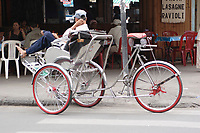 """Hanoi<br /> , Vietnam - 2007 File Photo -<br /> <br /> A cyclo"""" (three-wheel covered bicycle) operator take a break in from on a sidewalk restaurant in hanoi.<br /> <br /> <br /> <br /> photo : James Wong-  Images Distribution"""