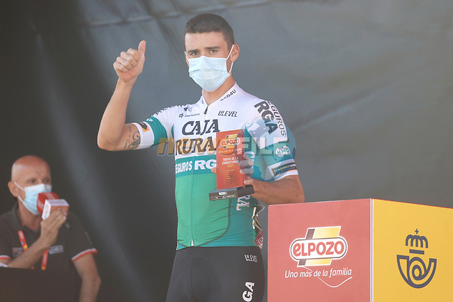 Álvaro Cuadros (ESP) Caja Rural-Seguros RGA most aggressive rider from yesterday's stage at sign on before the start of Stage 14 of La Vuelta d'Espana 2021, running 165.7km from Don Benito to Pico Villuercas, Spain. 28th August 2021.     <br /> Picture: Luis Angel Gomez/Photogomezsport | Cyclefile<br /> <br /> All photos usage must carry mandatory copyright credit (© Cyclefile | Luis Angel Gomez/Photogomezsport)