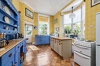 BNPS.co.uk (01202 558833)<br /> Pic: KnightFrank/BNPS<br /> <br /> Pictured: The kitchen.<br /> <br /> A spectacular Georgian mansion that was home to an eccentric and legendary poet during the war is on the market for £10.5m.<br /> <br /> Grade II* Listed South End House was home to Walter de la Mare in the 1940s and the writer was reprimanded for failing to observe the blackout during the Second World War.<br /> <br /> The impressive property is in a prime location on an exclusive cul-de-sac with incredible park views and glimpses of the Thames.<br /> <br /> On one occasion during the war, police rowed across the river to complain his upper windows were beaconing to the far bank.