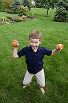 Nate with, tomato, outdoors at Barb and Richard's home, Columbus, Ohio, USA