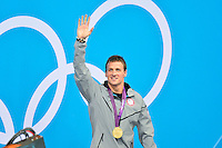 July 28, 2012: Ryan Lochte of USA waves at the spectators during award ceremony for Men's 400m Individual Medley event at the Aquatics Center on day one of 2012 Olympic Games in London, United Kingdom.