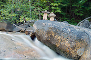 Rock stacking along the Swift River near the Kancamagus Highway (route 112) in the White Mountains, New Hampshire.