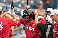 Louisville Cardinals shortstop Tyler Fitzgerald (2) celebrates and is awarded a Louisville football helmet after hitting a first inning home run during Game 7 of the NCAA College World Series against the Auburn Tigers on June 18, 2019 at TD Ameritrade Park in Omaha, Nebraska. Louisville defeated Auburn 5-3. (Andrew Woolley/Four Seam Images)