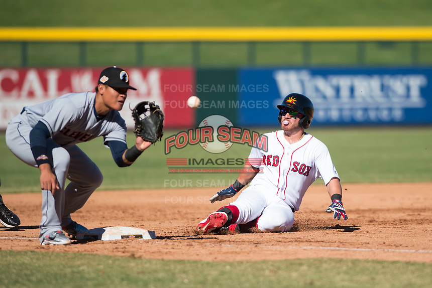 Mesa Solar Sox second baseman Esteban Quiroz (2), of the Boston Red Sox organization, slides into third base as Yu Chang (9) waits to receive a throw during an Arizona Fall League game against the Glendale Desert Dogs at Sloan Park on October 27, 2018 in Mesa, Arizona. Glendale defeated Mesa 7-6. (Zachary Lucy/Four Seam Images)