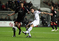 Pictured: Owain Tudur Jones of Swansea (R) shoots the ball off target while marked by Dennis Souza of Barnsley (L)<br /> Re: Coca Cola Championship, Swansea City FC v Barnsley at the Liberty Stadium. Swansea, south Wales, Tuesday 09 December 2008.<br /> Picture by D Legakis Photography / Athena Picture Agency, Swansea 07815441513