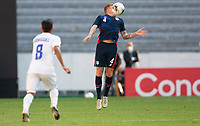 GUADALAJARA, MEXICO - MARCH 28: Justen Glad #4 of the United States traps the ball during a game between Honduras and USMNT U-23 at Estadio Jalisco on March 28, 2021 in Guadalajara, Mexico.