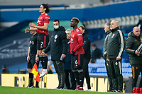 7th November 2020; Liverpool, England; Manchester Uniteds Paul Pogba and Edinson Cavani prepare to come on as substitutes during the Premier League match between Everton and Manchester United at Goodison Park Stadium