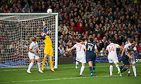 Manchester, England - Monday, August 6, 2012: The USA defeated Canada 4-3 in overtime in the semi-final round of the 2012 London Olympics at Old Trafford. Alex Morgan heads the ball in for a goal over the head of Canada's goalkeeper Erin McLeod.