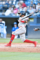 Lakewood BlueClaws Jonathan Guzman (4) swings at a pitch during a game against the Asheville Tourists at McCormick Field on June 14, 2019 in Asheville, North Carolina. The BlueClaws defeated the Tourists 7-5. (Tony Farlow/Four Seam Images)