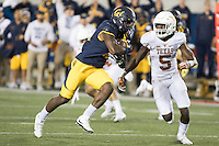 BERKELEY, CA - September 17, 2016: Cal's (15) Jordan Veasy scrambles for some additional yards while Texas defender (5) Holton Hill tries to stop him at Cal Memorial Stadium.