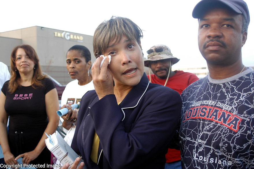 New Orleans councilwoman Cynthia Lewis Scott wipes away tears while talking to 7th district New Orleans residents who have come home for the first time since Hurricane Katrina.