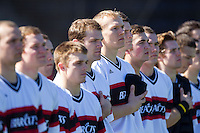 Ian Happ (center) and his Cincinnati Bearcats teammates stand for the National Anthem prior to the game against the Radford Highlanders at Wake Forest Baseball Park on February 22, 2014 in Winston-Salem, North Carolina.  The Highlanders defeated the Bearcats 6-5.  (Brian Westerholt/Four Seam Images)