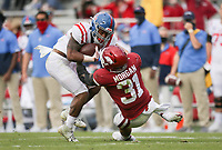 Arkansas linebacker Grant Morgan (31) tackles Ole Miss running back Jerrion Ealy (9), Saturday, October 17, 2020 during the second quarter of a football game at Donald W. Reynolds Razorback Stadium in Fayetteville. Check out nwaonline.com/201018Daily/ for today's photo gallery. <br /> (NWA Democrat-Gazette/Charlie Kaijo)